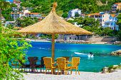 Fantastic Summer Holiday Destination. Cozy Outdoor Tropical Beach Bar With Straw Parasols And Beauti poster