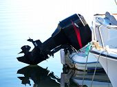 picture of outboard engine  - black big outboard engine on the sea boat