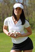 Woman Golfer Holding Golf Balls