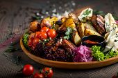 Tasty Dish With Meat And Vegetables, Baked Pork, Cowboy Grill, Grilled Potatoes With Sauce. Assorted poster