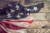 Patriotic Symbols. American Flag On An Old Wooden Background. poster