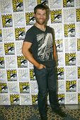 SAN DIEGO, CA - JULY 13: Liam McIntyre arrives at the 2012 Comic Con convention press room at the Ba