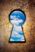 Sky In Keyhole On Old Wall