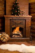 foto of cozy hearth  - Photo of fireplace with firewood and warm white fur near by - JPG