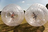 stock photo of inflatable slide  - children have a lot of fun in the Zorbing Ball - JPG