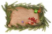 branch of Christmas tree wooden background