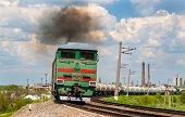 Freight Train Hauled By Diesel Locomotive. Ukrainian Railways