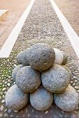 picture of cannon-ball  - old stone cannon ball on courtyard of The Castle Estense in Ferrara Italy - JPG