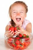 A Child With A Bowl Fresh Strawberries