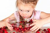A Child With A Bowl Fresh Cherry