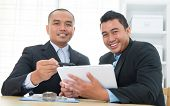 stock photo of ebusiness  - Southeast Asian business people on ebusiness activity - JPG