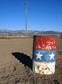 foto of barrel racing  - An old painted barrel in a rural rodeo arena - JPG