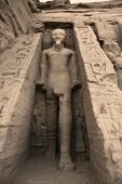 stock photo of nubian  - Statue of Rameses II outside the Hathor Temple of Queen Nefertari - JPG