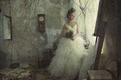 Romantic young bride in vintage interior in autumn style.