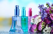 Women perfume in beautiful bottles and flowers