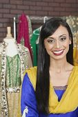stock photo of dupatta  - Portrait of a pretty Indian female dressmaker smiling - JPG