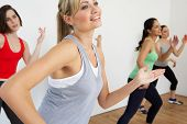 stock photo of stretching exercises  - Group Of Women Exercising In Dance Studio - JPG