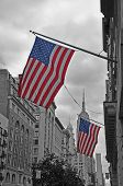 stock photo of empire state building  - Flags of the USA in a building near the Empire State Building in New York City - JPG
