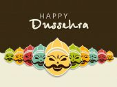 stock photo of navratri  - Indian festival Happy Dussehra concept with illustration of smiling Ravana face with his ten heads in various colors - JPG