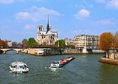 Passenger cruise at Cathedral Notre Dame, river Seine Paris France