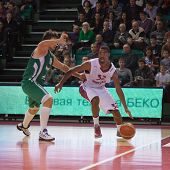 stock photo of mile  - SAMARA RUSSIA - DECEMBER 02: Aaron Miles of BC Krasnye Krylia with ball tries to go past a BC UNICS player on December 02 2012 in Samara Russia.