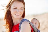 Beautiful woman with a baby in a sling. Mom and baby. Mother and child.