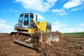 loader track-type bulldozer excavator machine doing earthmoving work at sandpit