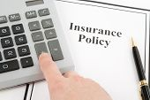 pic of insurance-policy  - Document of Insurance Policy and calculator for background - JPG