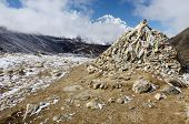 Stone Cairn With Religious Tibetan Flags Marks A Sacred Buddhist Place,Everest Region,Nepal