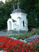 Monument With Red And Blue Flower Beds