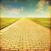 Stone pathway in the field.Grunge and retro style.