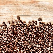 Roasted Coffee Beans Background Texture On Wooden Background Frame With Copy Space For Text, Macro.