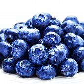 Blueberries On White Plate Isolated On White Background With Copy Space For Text, Close Up. Group Of