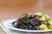stock photo of liver fry  - liver fried with boiled potatoes on a plate - JPG
