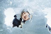 stock photo of scrape  - Man scraping snow and ice from car window - JPG