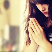 image of kneeling  - Closeup portrait of a young caucasian woman praying - JPG