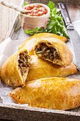 empanadas with ground meat and salsa
