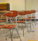 stock photo of students classroom  - An empty classroom with school desks waiting quietly for students to arrive - JPG