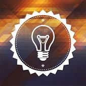 Light Bulb Icon on Triangle Background.