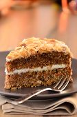 picture of sponge-cake  - Slice of carrot cake with cheese cream frosting and almonds flakes - JPG