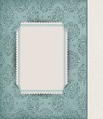 image of slit  - Corner slit frame on teal damask background - JPG