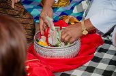 foto of dowry  - Engaged bride groom take the money brought by the relatives of both parties agreed - JPG