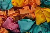 Colorful group of crumpled paper balls.