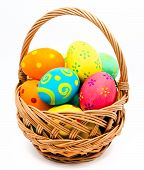 image of gift basket  - Colorful handmade easter eggs in the basket isolated on a white background - JPG