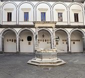 Columns And Old Well In The Certosa Di San Martino - Monastery At Naples, Italy
