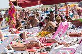 People Getting Sun Tanning