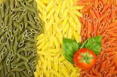 stock photo of italian flag  - Pasta Italian flag texture with tomato and basil - JPG