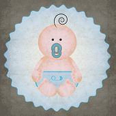Cute little baby boy with blue diaper and pacifier on gray texture background