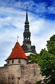 View on a tower of a city wall and St. Nicholas' Church (Niguliste). Old city Tallinn Estonia