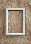 Frame On Beige Wrinkled Paper